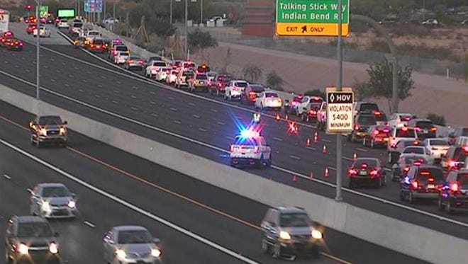Traffic is exiting at Indian Bend Road after a crash forced the closure of northbound Loop 101 in Scottsdale on Dec. 15, 2017.