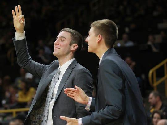 Iowa's Connor McCaffery, left, celebrates a 3-pointer from Luka Garza during Iowa's Dec. 29, 2017, win against Northern Illinois. McCaffery appeared in four games this past seasonas a backup point guard.