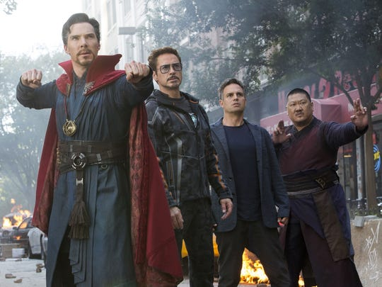 "Doctor Strange (Benedict Cumberbatch, left) wields the Eye of Agamotto in battle alongside fellow heroes Tony Stark (Robert Downey Jr.), Bruce Banner (Mark Ruffalo) and Wong (Benedict Wong) in ""Avengers: Infinity War."""