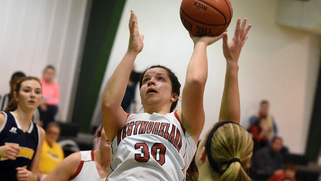 Westmoreland senior Karley Smith elevates for an interior shot during second-quarter action. Smith scored 24 points in the Lady Eagles' 70-65, double-overtime victory.