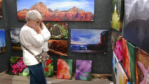An assortment of fine art is available at the Sidewalk Arts Festival.