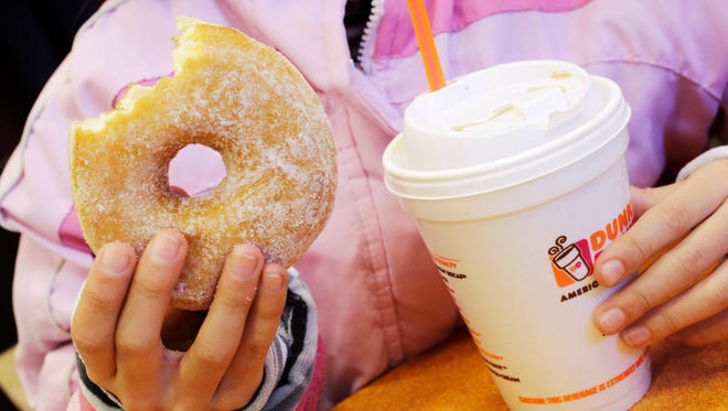 Dunkin? Brands CEO Nigel Travis said that the company is pushing to get its cashiers to ?upsell? to afternoon customers.