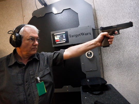 In this March 11, 2016 photo, Dr. Michael Victoroff, a physician in the Denver area whose leisure-time passion is competitive shooting, practices at a range in Centennial, Colo. Across the U.S., suicides account for nearly two-thirds of all gun deaths, with 21,334 gun deaths by suicide in 2014, according to federal data. Victoroff has become increasingly engaged in suicide prevention, and serves on a state working group seeking to raise awareness of the issue among primary-care doctors.
