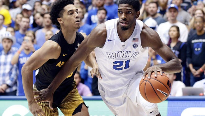 Duke's Amile Jefferson (21) drives to the basket against Appalachian State's Patrick Good during the first half of an NCAA college basketball game in Durham on Saturday, Nov. 26, 2016. (AP Photo/Gerry Broome)