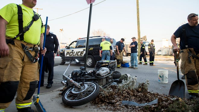Emergency responders clean up debris from a motorcycle accident in Hanover Borough on Thursday, March 9.