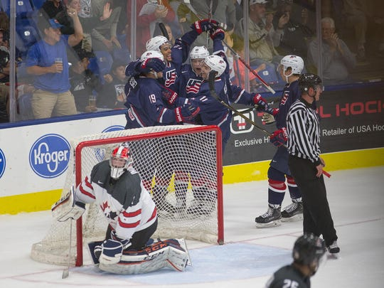Team Canada goalie Connor Ingram kneels dejectedly in his crease as Team USA players celebrate a goal by Jordan Greenway. Here's hoping Ingram has happier moments in a Predators uniform.