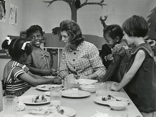 Eunice Kennedy Shriver visits with children in a model preschool classroom at the Kennedy Center in the early 1970s.