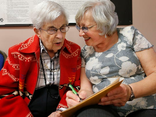 Sandra Goff, right, helps her aunt, Loraine Roberts,