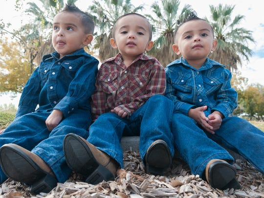 Pictured are the 2-year-old Artiaga triplets Benjamin,