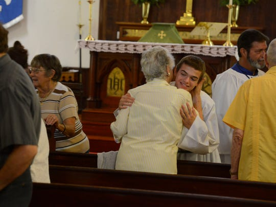 Parishioners greet each other at St. Mary's Episcopal Church in Milton Sunday, July 16, 2017. August 4, the church will be 150 years old.