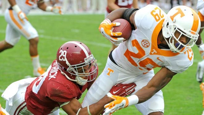 Tennessee's Evan Berry (29) is tackled by Alabama defensive back Minkah Fitzpatrick (29) during an NCAA college football game in Tuscaloosa, Ala. Saturday, Oct. 24, 2015. Alabama won 19-14.