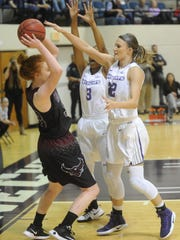 Abilene Christian's Sierra Allen, right, and Dominique Golightly, center, pressure McMurry's Mackenzie Kimball player during their exhibition game Nov. 7, 2016 at Moody Coliseum.