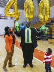 Dunbar girls basketball coach Dwayne Donnell, celebrating his 400th career victory with his wife and grandson, has lost 200 pounds.
