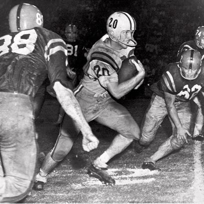 In this Oct. 31, 1959, file photo, Billy Cannon, LSU's