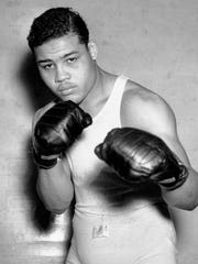 Boxer Joe Louis, nicknamed the Brown Bomber, posing