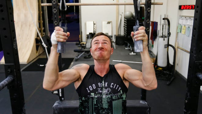 """Joseph Landry of Des Moines trains for the """"American Ninja Warrior"""" competition Thursday, April 21, 2016 at TGR fitness in Des Moines."""