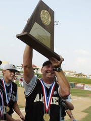 Times Record News Archer City head coach Pat Maxwell hoists the championship trophy after his Wildcats won the 2007 UIL Class A baseball state title with a 6-2 victory over the New Deal Lions.