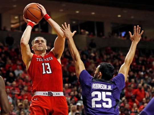 Texas Tech's Matt Mooney (13) jumps back to shoot the ball over TCU's Alex Robinson (25) during the second half of an NCAA college basketball game Monday, Jan. 28, 2019, in Lubbock, Texas. (AP Photo/Brad Tollefson)