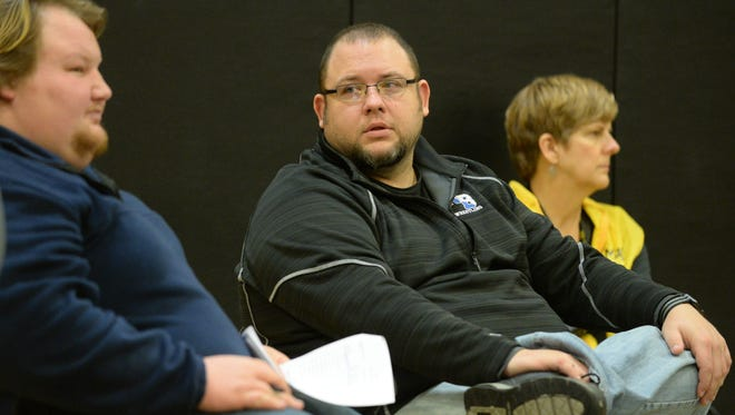Longtime Northern Burlington wrestling coach Jule Dolci, right looks at Cody Melton, left, at a meet last winter. Melton got approved to fill the spot of head coach last May. Dolci stepped stepped down from the role.