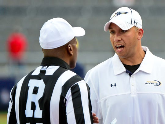 Toledo Rockets head coach Matt Campbell talks with