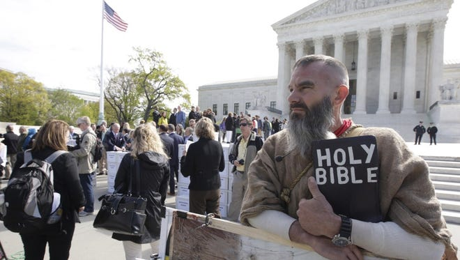 A traditional marriage proponent outside the Supreme Court of the United States.