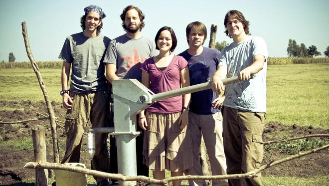 Nashville-based Christian band Jars of Clay co-founded Blood:Water with Jena Lee Nardella. Here they stand together at the site of a well in Kenya. Left to right: Stephen Mason, Matthew Odmark, Nardella, Charlie Lowell and Dan Haseltine.