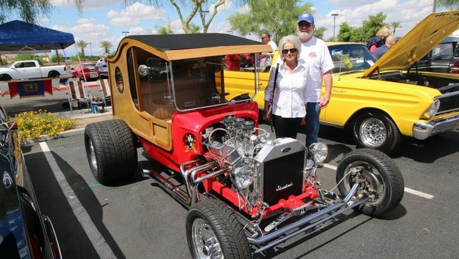 Michaela Geesey of Sun City and her husband pose next to her 1917 Ford C-cab, which is powered by a 327-cubic-inch Corvette V-8 with aluminum heads and triple two-barrel carburetors.