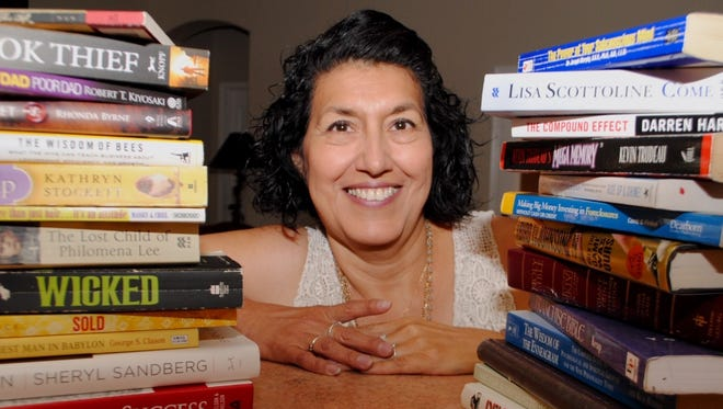 Margo Bencomo uses many of her favorite books to keep her Little Library filled with a variety of titles. The often anonymous patrons are encouraged to 'take one and leave one.'