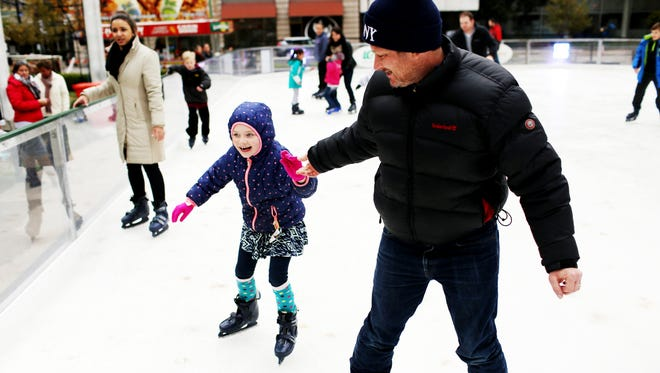 Open on Christmas, Holiday in the City rink on Fourth and Jefferson streets in downtown Louisville is a fun way to spend the day. Here, Bill Hardt ice skates with his daughter, Magnolia, the day after Thanksgiving.