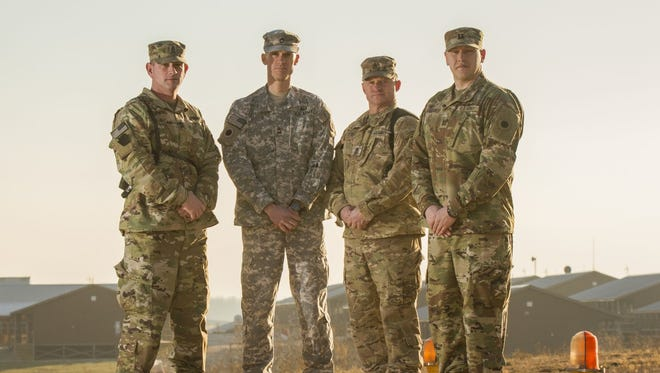 From left-to-right: Sergeant Major Robert Corner, Sergeant First Class Chad Harris, First Sergeant Michael Glenn and Captain Michael McQueary.