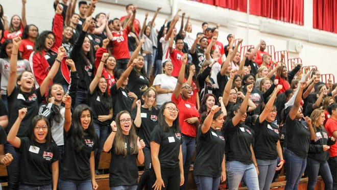 Upperclassmen cheer on the freshman class as they enter the gym.