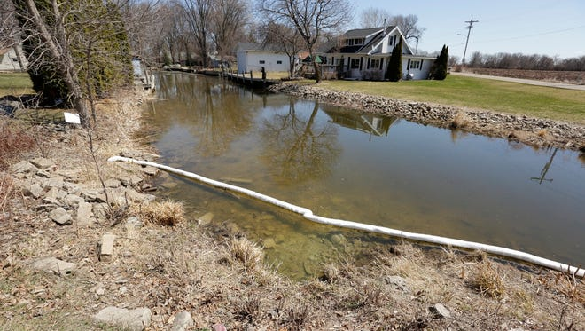 Local residents reported seeing a white foamy substance Tuesday, April 24, 2018, on a creek near County A and Cozy Lane, a day after a fire at A.P. Nonweiler produced small amounts of titanium dioxide residue.