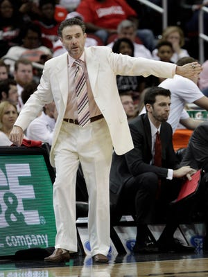 University of Louisville head coach Rick Pitino reacts to his teams play against the University North Carolina during the first half of play at the KFC Yum! Center in Louisville, Kentucky.       January 31, 2015