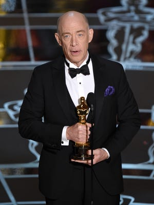 "J.K. Simmons accepts the award for best actor in a supporting role for ""Whiplash"" at the Oscars on Sunday, Feb. 22, 2015, at the Dolby Theatre in Los Angeles."