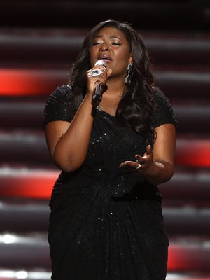 """Winner Candice Glover performs at the """"American Idol"""" finale at the Nokia Theatre at L.A. Live on Thursday, May 16, 2013, in Los Angeles. (Photo by Matt Sayles/Invision/AP)"""