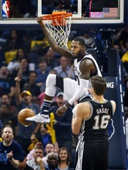 Grizzlies forward JaMychal Green (top) dunks over Spurs defender Pau Gasol during the second quarter of Game 4 of their NBA first-round playoff series last season.