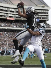 Oakland Raiders wide receiver Seth Roberts catches a touchdown pass over Carolina Panthers cornerback Robert McClain during a game on Nov. 27, 2016.