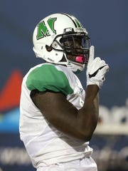 Emanuel Byrd celebrates a touchdown during Marshall's game at Florida International in 2016.