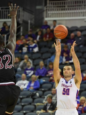 University of Evansville's Blake Simmons (50) shoot from the outside as the University of Evansville play North Carolina Central for Kids Day at the Evansville Ford Center Monday, November 13, 2017.