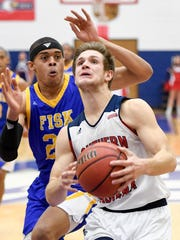 USI's Alex Stein, driving past Fisk's Howard Smothers (25) in a win on Monday, contributed 11 points in an 84-56 victory over Martin Methodist Saturday at the PAC.