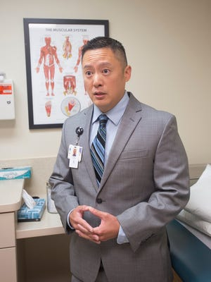 Dr. Huaiyu Tan, an interventional pain medicine physician with the Andrews Institute for Orthopaedics & Sports Medicine, talks about alternatives to opioids at Baptist Hospital in Pensacola on Friday, June 1, 2018.