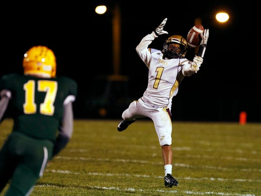 Lincoln wide receiver Vaughn Fleming (1) catches the