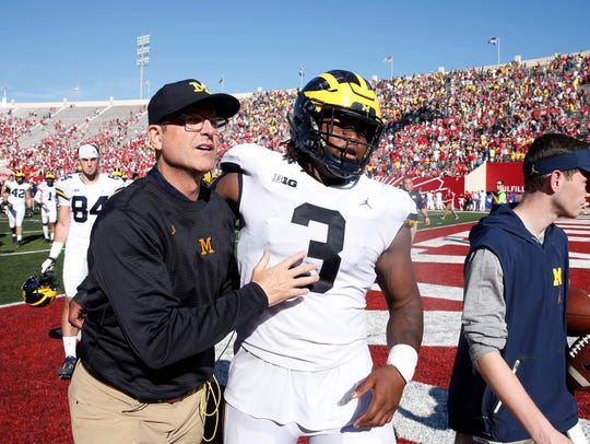 MIchigan football coach Jim Harbaugh and defensive end Rashan Gary after last season's 27-20 win over the Hoosiers.