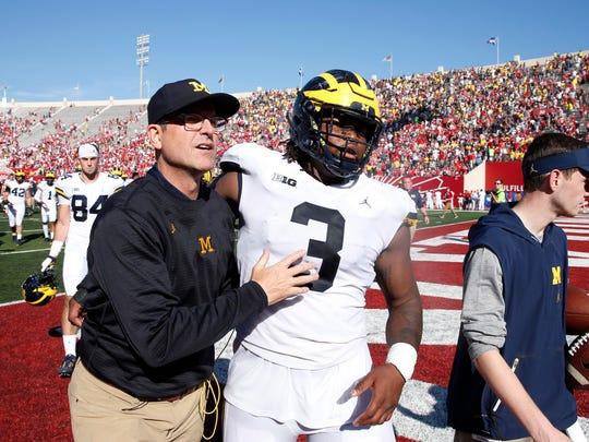 Michigan coach Jim Harbaugh, left, and defensive lineman Rashan Gary (3) will need to win some spotlight games this season.