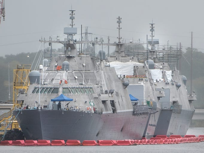 The new USS Detroit, front, is the U.S. Navy's relatively