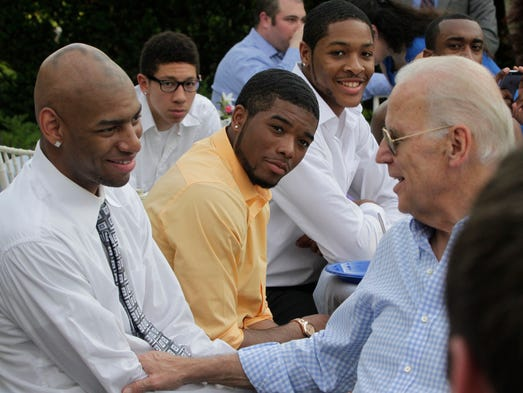 Vice President Joe Biden chats with University of Delaware men's basketball team members including (from left) Barnett Harris, Devonne Pinkard, Cazmon Hayes and Maurice Jeffers at the Vice President's residence at the Naval Observatory in Washington, DC during the team's visit to the White House and Biden's residence, Thursday, May 8, 2014. The visit mirrored the women's team's visit two years prior, also following a CAA conference title run and NCAA appearance.