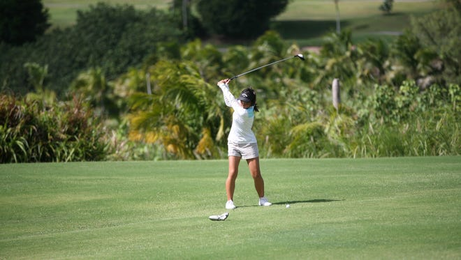 Kana Kawamura Bangs practices her swings at the Leo Palace Guam Resort. The teen golfer will represent Guam at the 73rd U.S. Women's Open Championship Sectional Qualifying Golf tournament in Ibaraki, Japan on May 8.