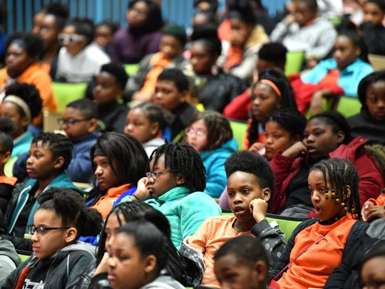 Students listen to speakers Wednesday, March 14, 2018