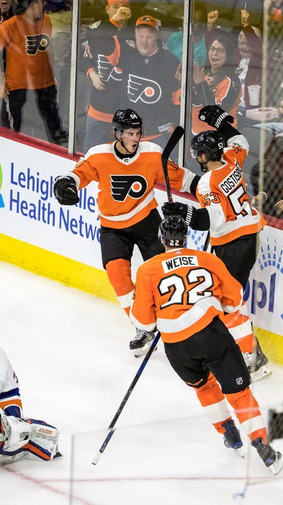 Philadelphia Flyers' Shayne Gostisbehere, right, celebrates