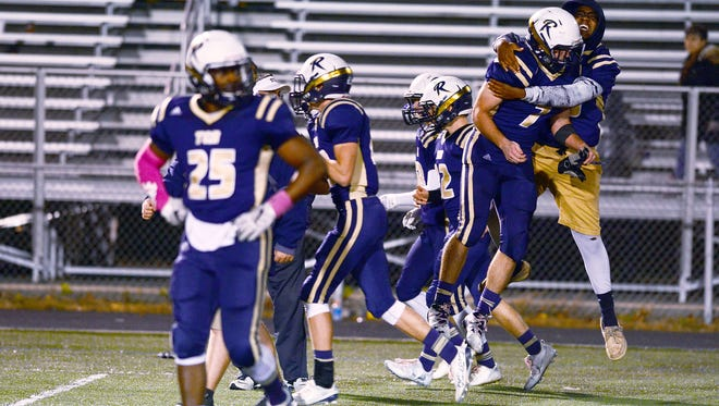 Roberson football players celebrate Friday's 12-11 home win over Asheville High.